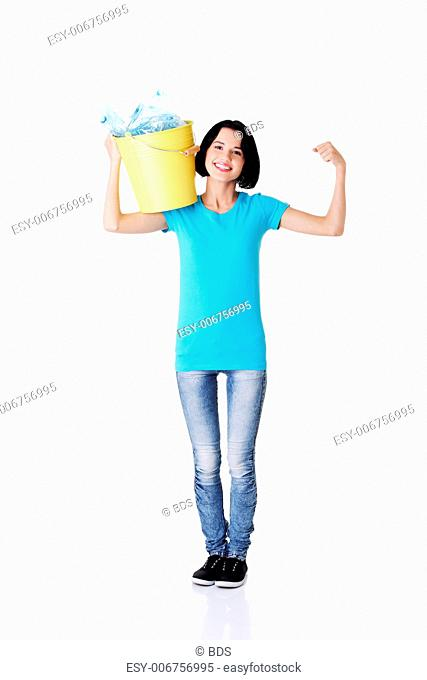 Beautiful young woman holding recycling bin isolated on white background