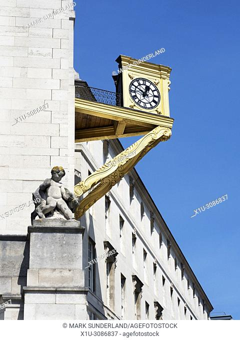 Gold Clock at Leeds Civic Hall in Millennium Square in Summer Leeds West Yorkshire England