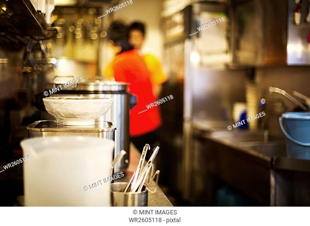 The ramen noodle shop. A man working in the kitchens