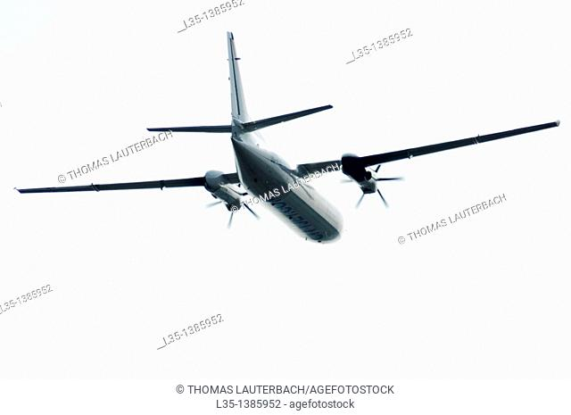 Turboprop aircraft in bright sky