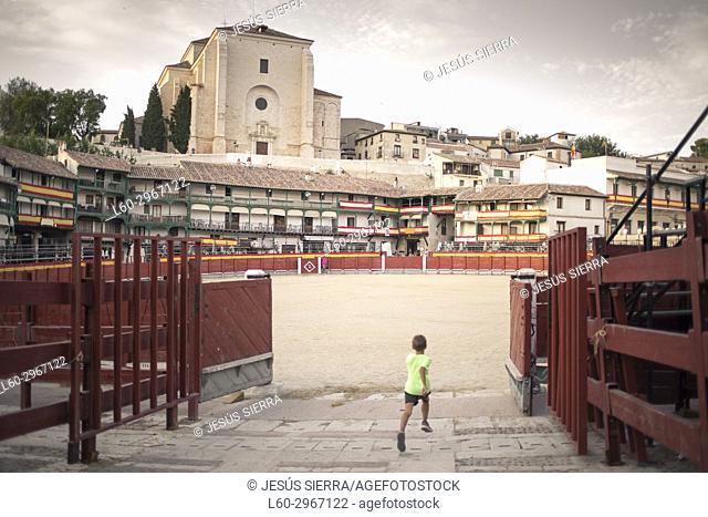 Boy running in Chinchón, Madrid province, Spain