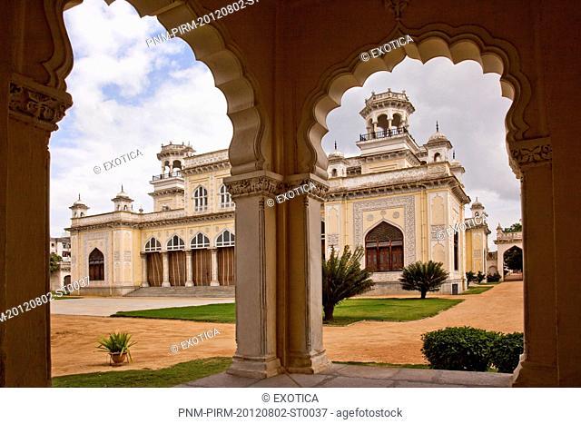 Facade of a palace viewed through arch, Chowmahalla Palace, Hyderabad, Andhra Pradesh, India