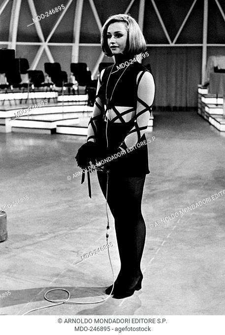 Raffaella Carrà with a miniskirt in a TV study. Italian dancer and presenter Raffaella Carrà with a miniskirt and bare tummy in the study of Canzonissima