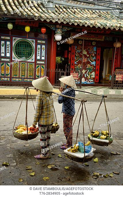 Vendors in front of the Quan Cong Temple, Hoi An, Vietnam