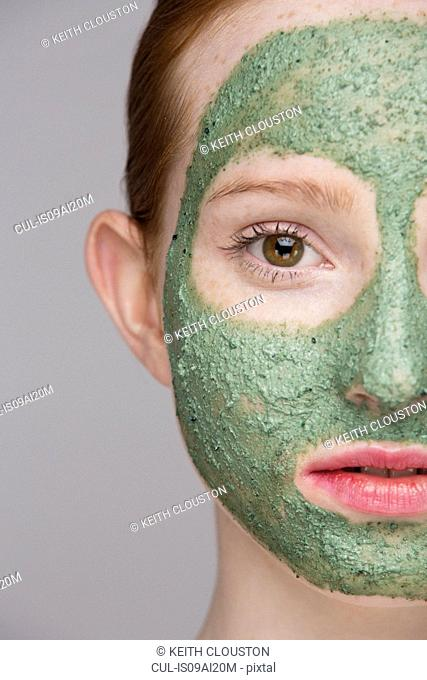 Cropped image of young woman wearing face mask