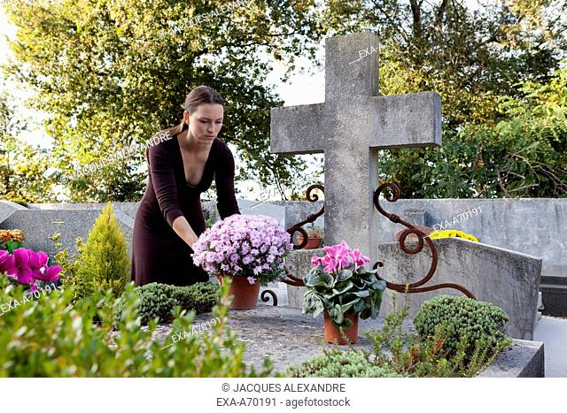 Woman mourns in a graveyard