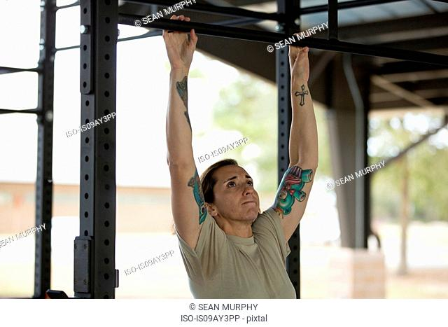 Female soldier pull up training at military air force base