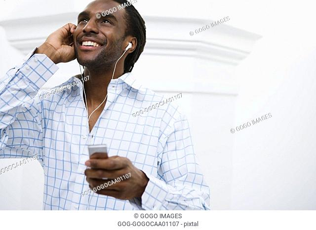 African man listening to mp3 player
