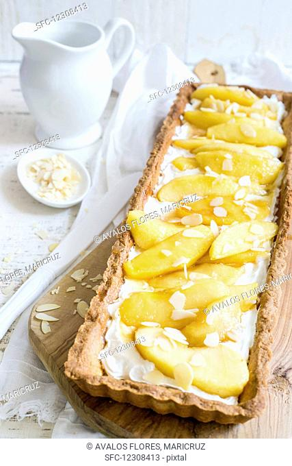 Caramelised apple tart with flaked almonds