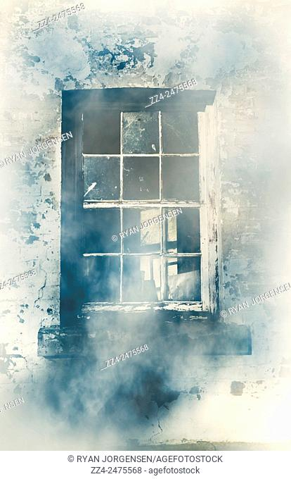 Architectural details on a broken old window in the foggy blue chill of winter. Dingy digs
