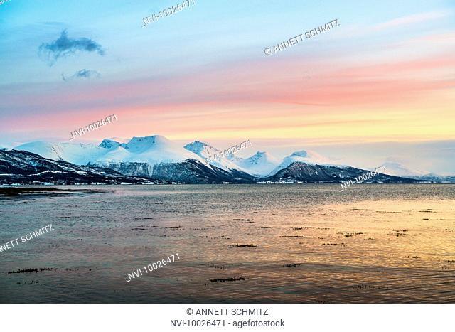 Sunset on the coast near Tisnes at Kvaløya island, Norway