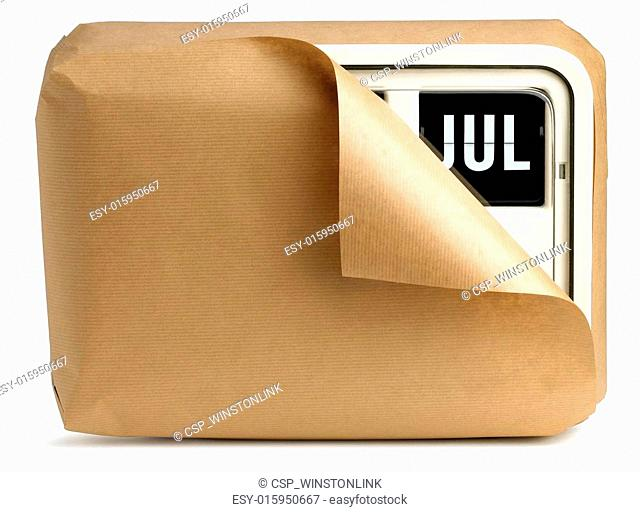 wall clock and calendar wrapped in brown paper isolated on a white background showing July