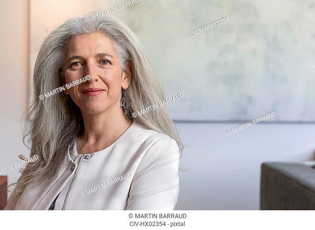 Portrait confident mature businesswoman