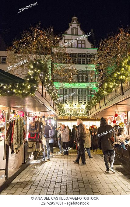 Christmas market at the home of the Heinzelmannchen on Heumarkt square, Cologne Germany