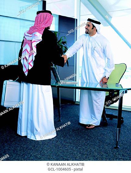 Saudi Arabian businessmen shaking hands