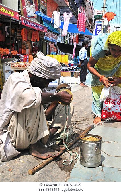 Blind man making music on the street