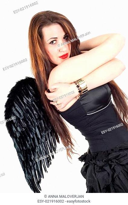 Beautiful brunette woman with black wings