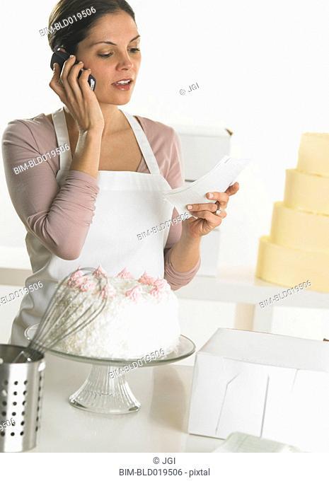Female baker talking on her cell phone