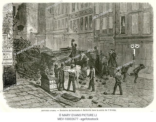 Rioters erect a barricade in the streets of Belleville, Paris, France