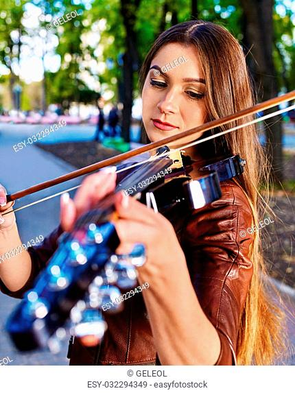 Music street performers girl violinist playing in park
