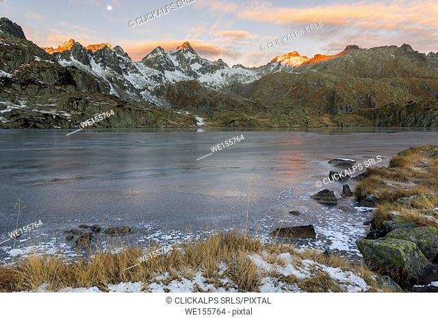 Italy, Trentino Alto Adige, Adamello Brenta Park, Nambrone valley, Dawn at Black Lake, in background Presanella group sunlit