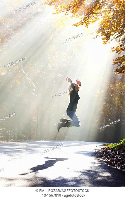 Young woman happy in Autumn