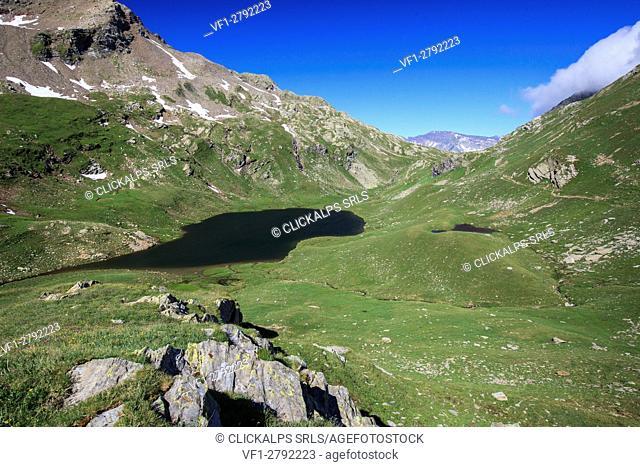 Lake Baldiscio surrounded by green pastures. Baldiscio Pass Campodolcino, Vallespluga, Valchiavenna, Lombardy, Italy Europe