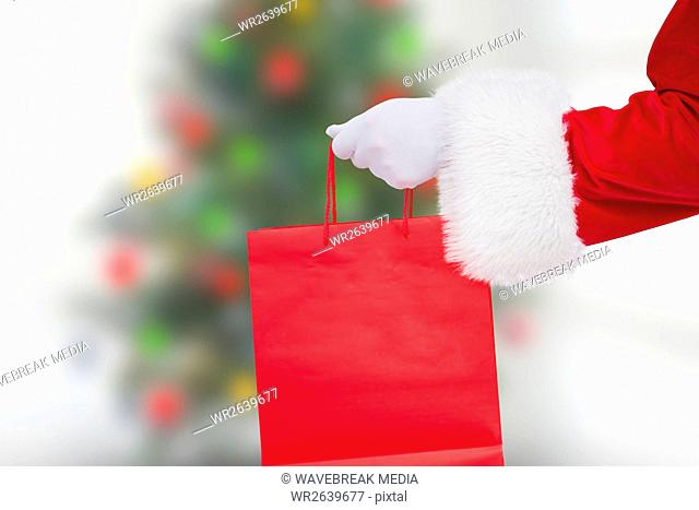 Santa claus holding shopping bag