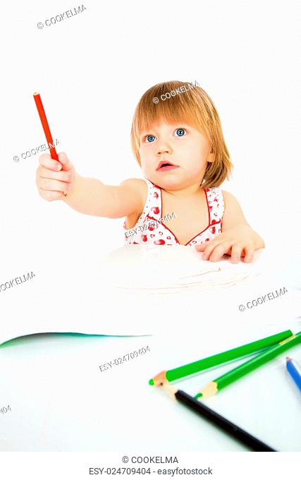 Little baby girl draws pencil on a white background