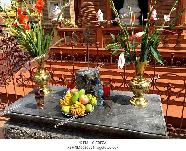 Phuong Yen Phu. Tran Quoc pagoda. Hanoi, Vietnam. Offerings