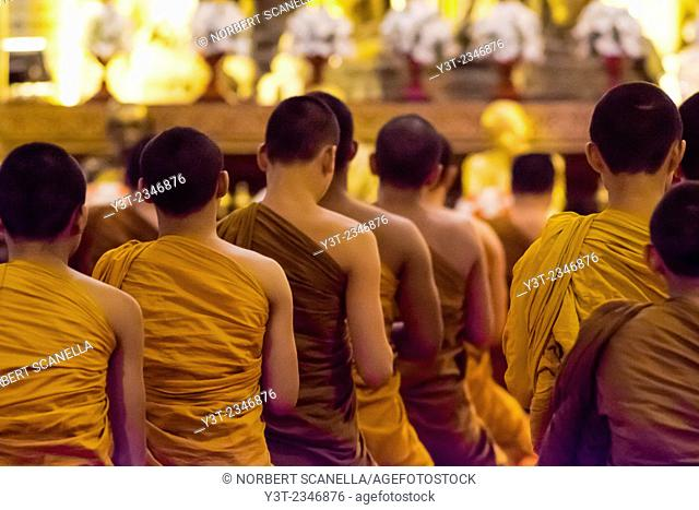 Asia. Thailand, Chiang Mai. Wat Phra Singh. Monks praying at temple