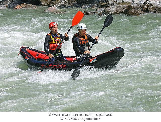 Two persons in double kayak boat
