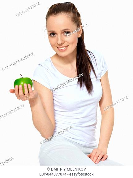 Sporty young woman with scales, fresh peppers and apple on a white background. Concept of healthy lifestyle