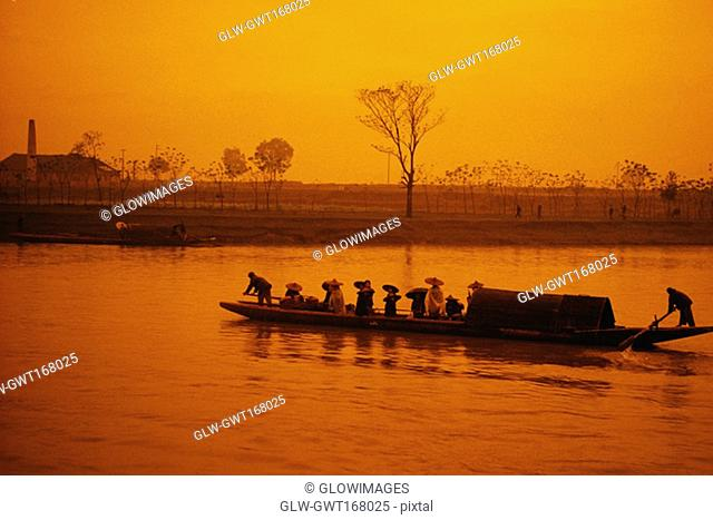 Silhouette of a boat at dusk, Li river, Guilin, China