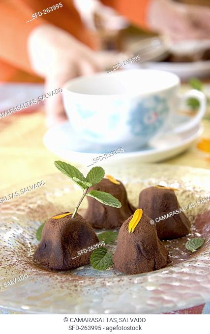 Chocolate truffles with mint and marigold petals