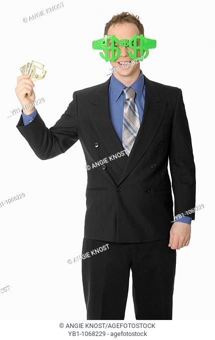 Business man with dollar sign glasses and money