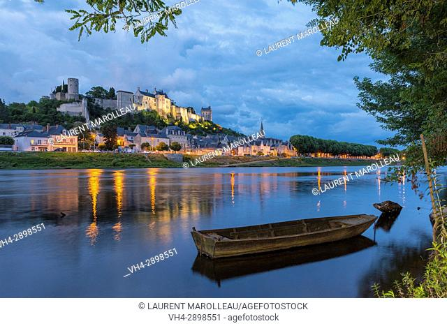 The banks of Vienne River, the City and the Royal Fortress of Chinon at Twilight. Indre-et-Loire, Central Region, Loire Valley, France, Europe