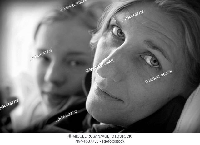 Black and white portrait of young woman with her teenage daughter