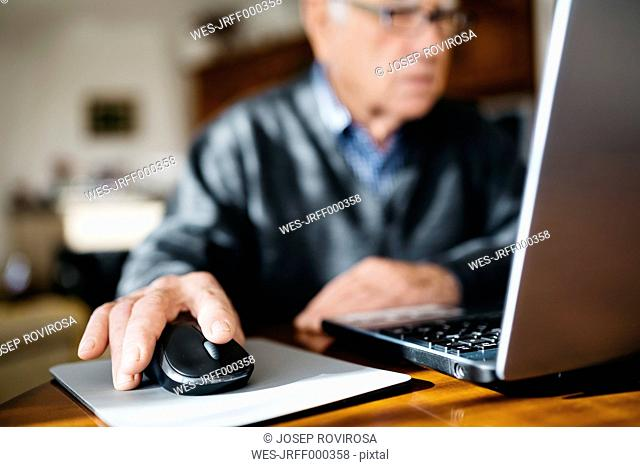 Hand of senior man using mouse, close-up