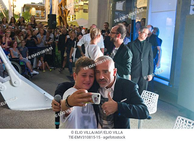 Eros Ramazzotti does a selfie with a young fan at Milan Expo 2015, Milan, ITALY-28-08-2015