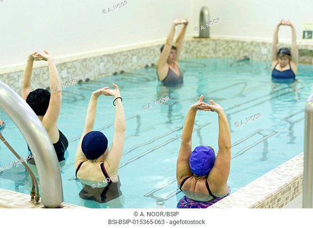 Reportage at the thermal baths in Lamalou-les-Bains, France. Rhumatology treatment. Aquagym lessons for a group of women suffering from fibromyalgia