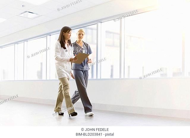 Doctor and nurse talking in hospital