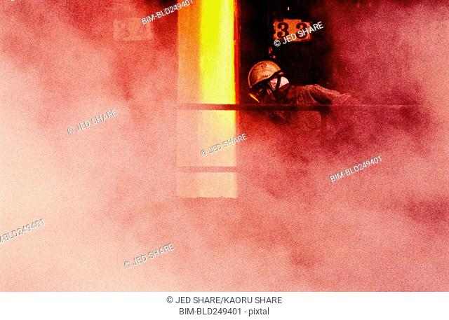 Person wearing mask in smoke