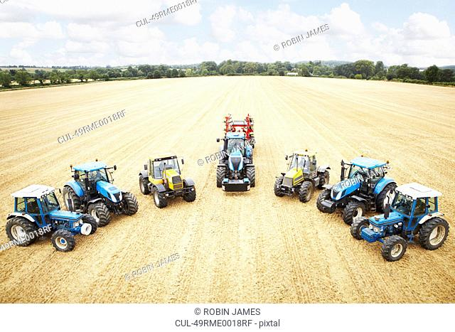 Tractors parked in tilled crop field