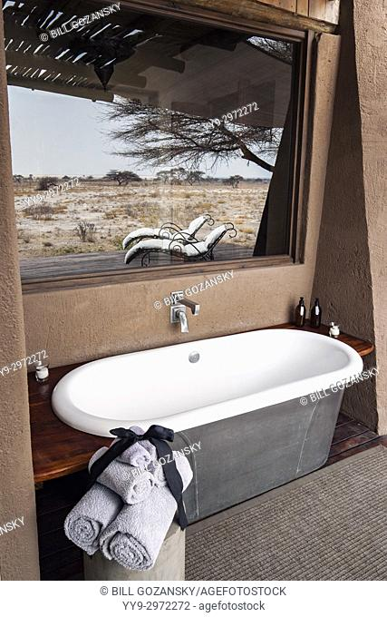 Outdoor bathtub in Honeymoon Suite at Onguma The Fort, Onguma Game Reserve, Namibia, Africa