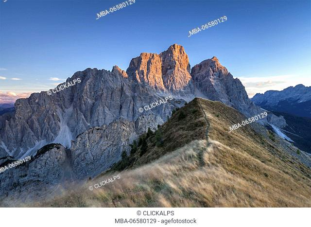 Europe, Italy, Veneto, Cadore, Autumnal sunset towards Mount Pelmo from the top of the Col de la Puina, Dolomites