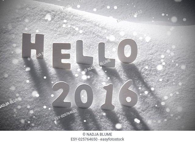 White Wooden Letters Building English Text Hello 2016. Snow And Snowy Scenery With Snowfalkes. Christmas Atmosphere. Christmas Background Or Christmas Card For...
