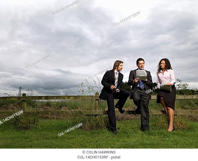 business meeting in field