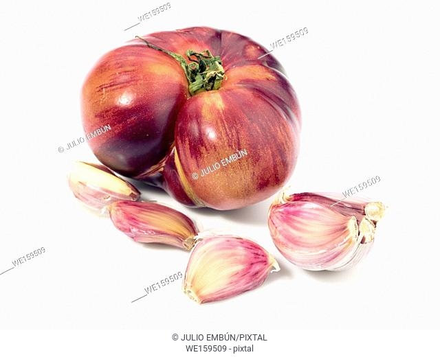 garlic and tomato cloves isolated on white