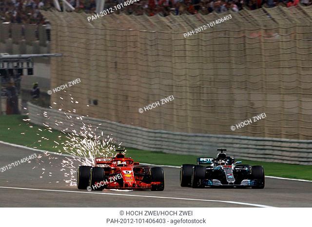 Motorsports: FIA Formula One World Championship 2018, Grand Prix of Bahrain, Sparks , #5 Sebastian Vettel (GER, Scuderia Ferrari)#44 Lewis Hamilton (GBR